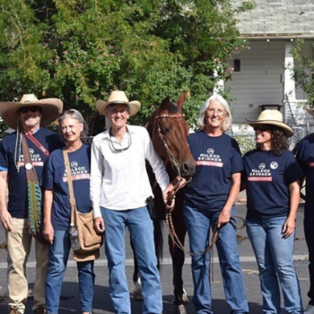 Jamie posing with constituents at a rodeo event